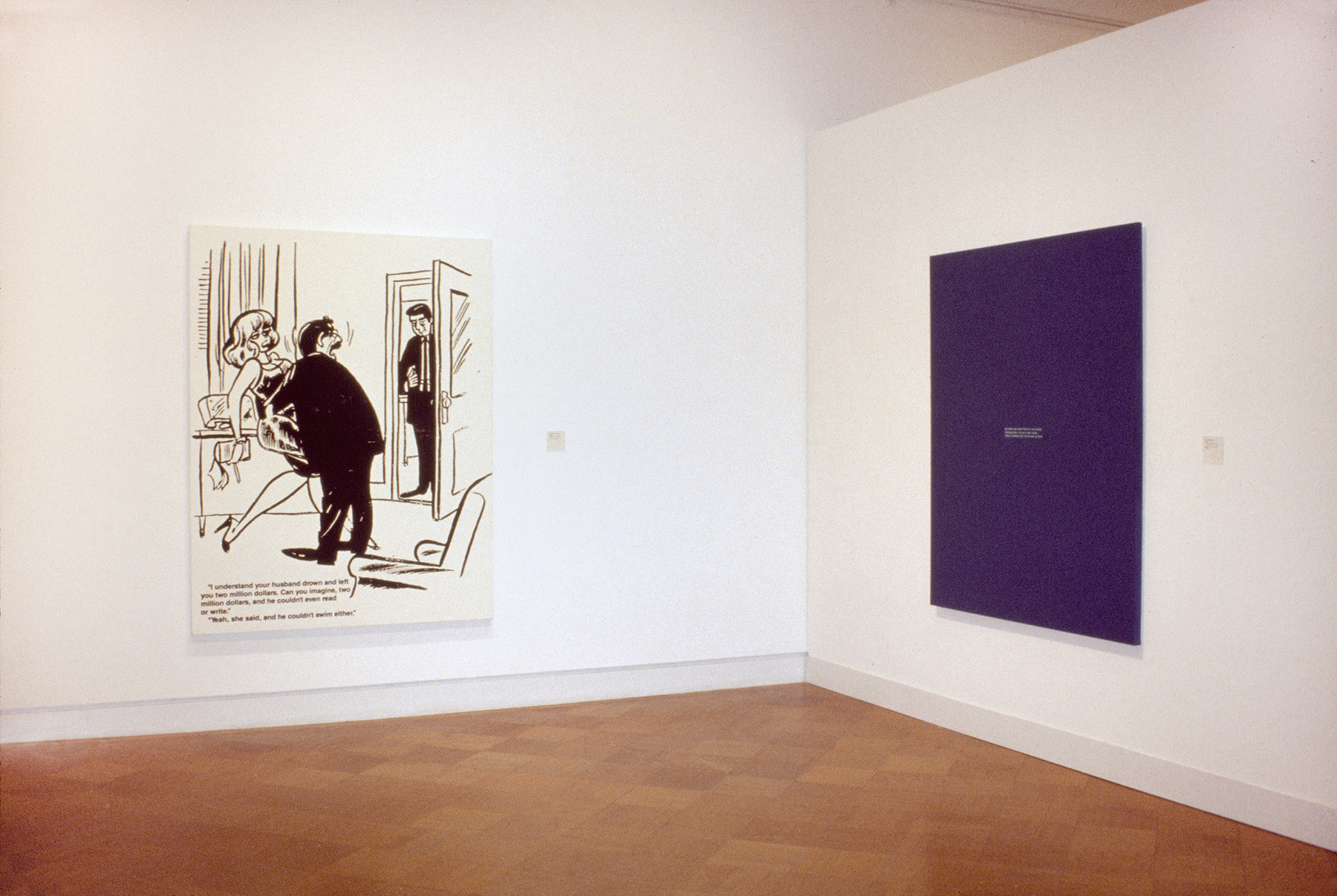 A large comic and a large purple canvas hanging in a gallery