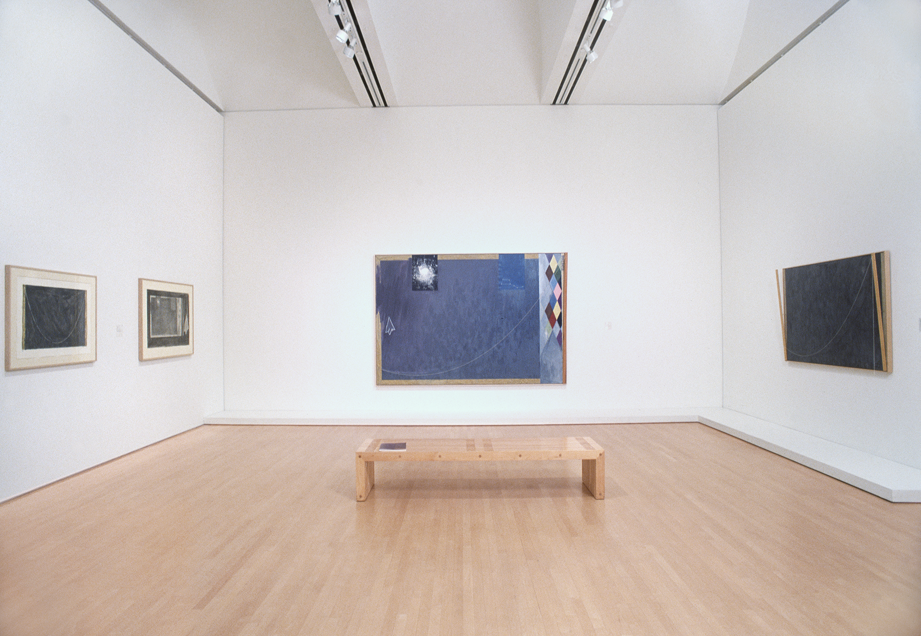 A room with four works by Jasper Johns