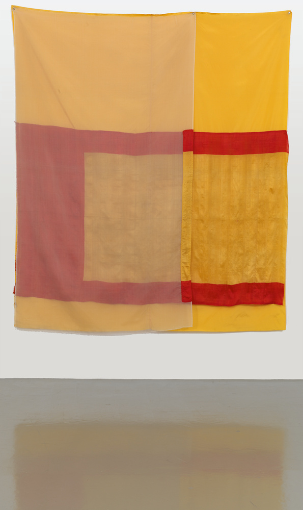 Hanging red, yellow and sheer fabric