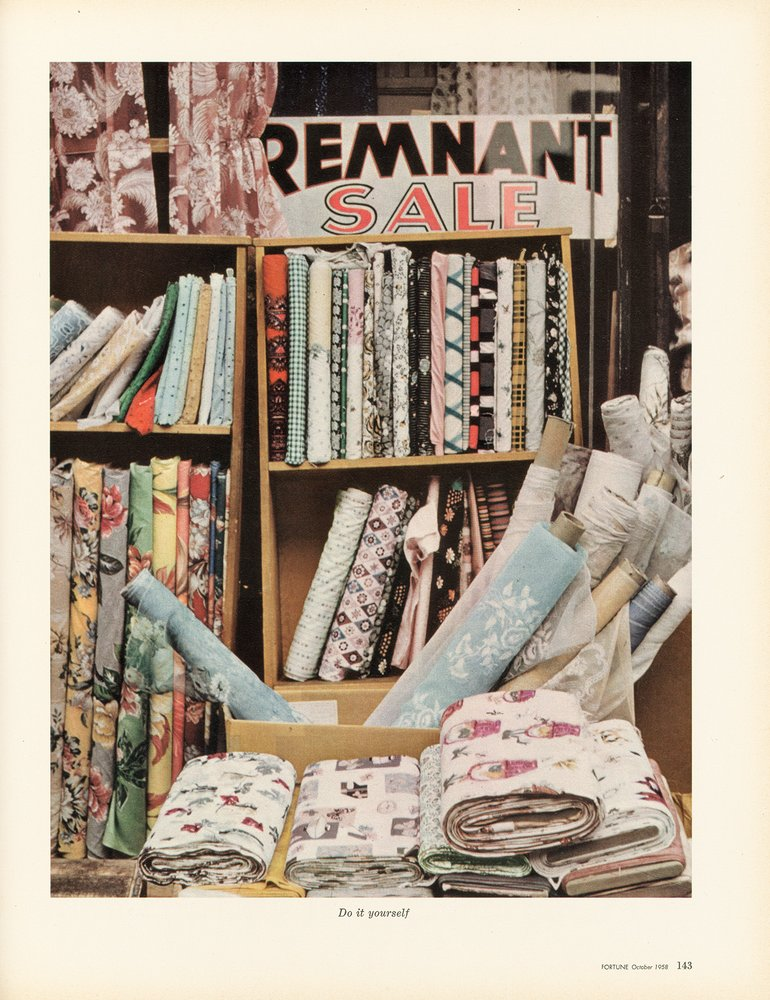 A color photograph of a fabric store display, Walker Evans