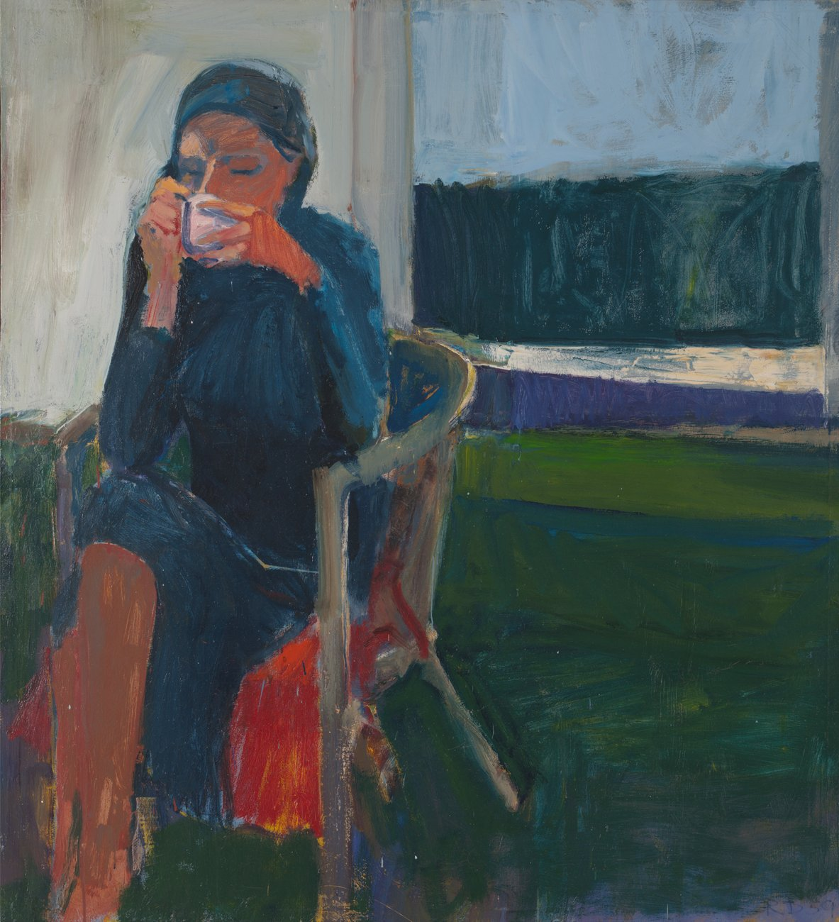 Seated woman drinking from a cup