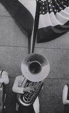 Robert Frank, photograph of man holding tuba and american flag