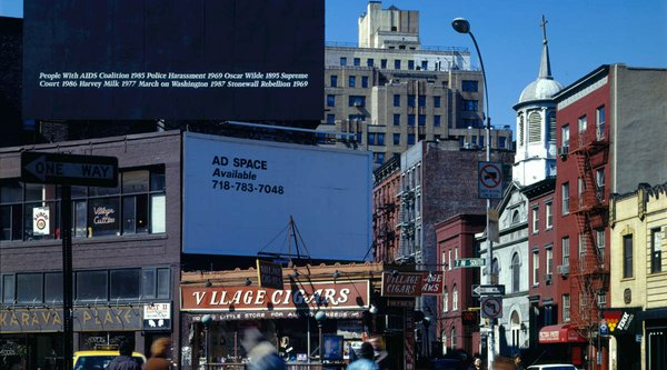 A cityscape featuring a black billboard, 50 Artists: Felix Gonzalez-Torres