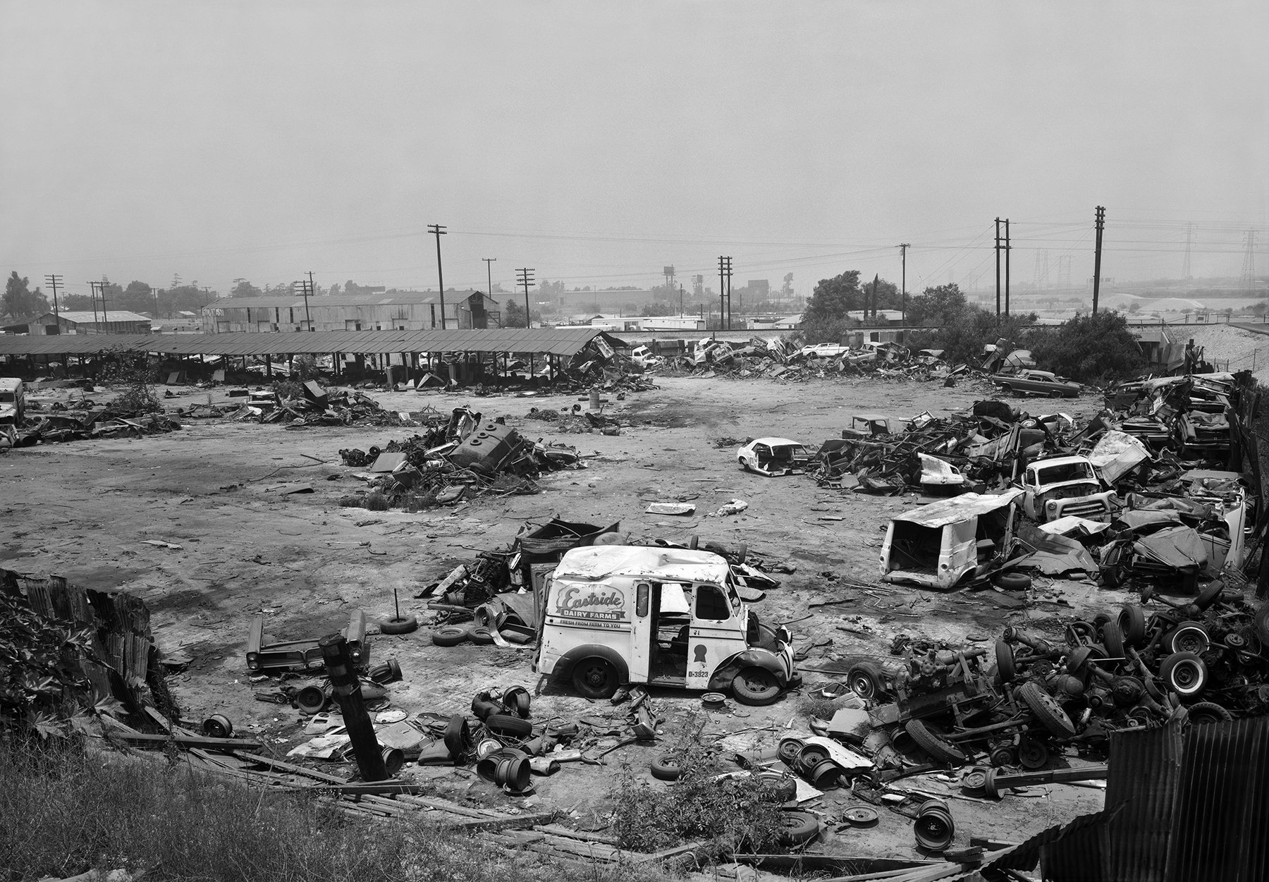 Black and white image of a metal scrap yard
