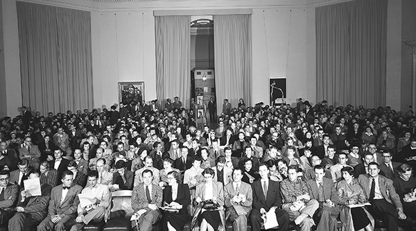 Seated audience in an auditorium, mid-century