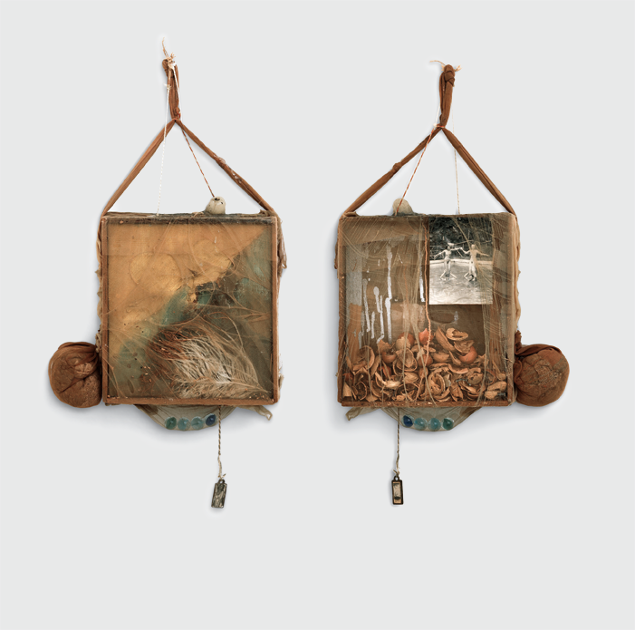 Two square assemblage artworks hang side by side on a white background