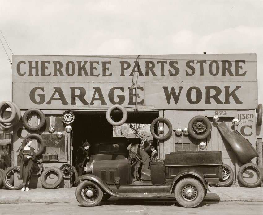 Black and white photograph of the exterior of a mechanic's garage, Walker Evans