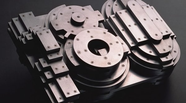 three-dimensional numeral 180 in metallic finish with screws