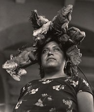 photograph of woman in Mexico with four iguanas on head