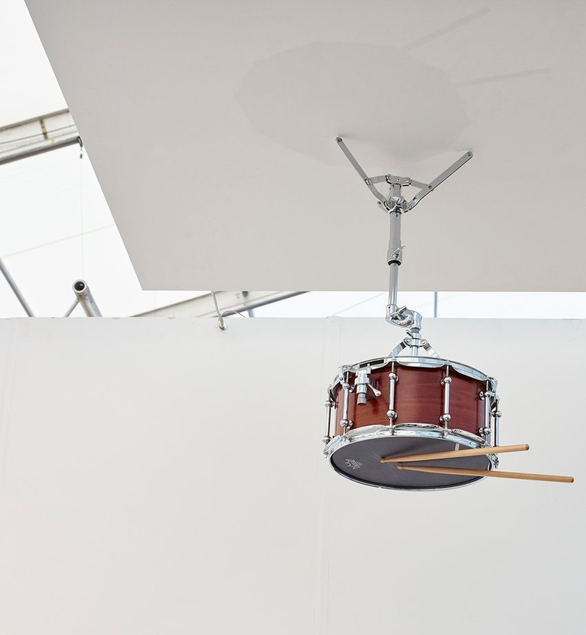 A photograph of a snare drum mounted on a ceiling, Sala Soundtracks