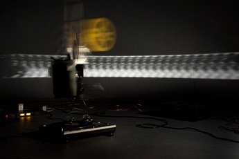 Mauricio Ancalmo, yellow film reel and light in motion
