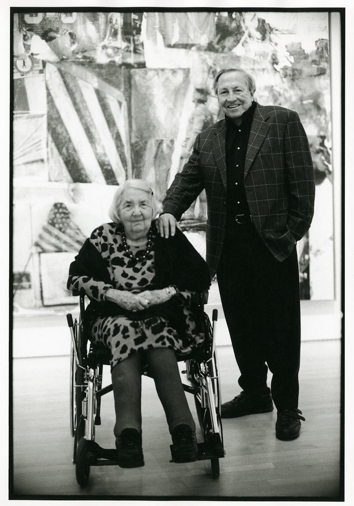 Black and white portrait of an elderly Caucasian woman in a wheel chair next to a standing Caucasian man, Wattis and Rauschenberg