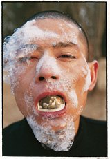 Color photograph of an Asian man smoking, Huan