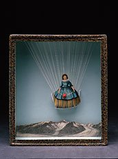 Cornell, sculpture of doll figure suspended above mountain in frame