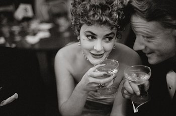 Garry Winogrand, photo of woman holding drink looking at man