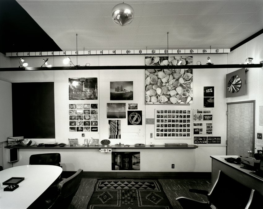 Black and white photograph of a mid-century modern conference room, ECR, Eames, Designed in CA