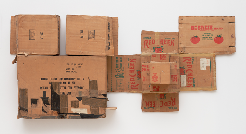 A horizontal arrangement of Rosalie Red Cheek brand  tomato cardboard boxes mounted on a white wall