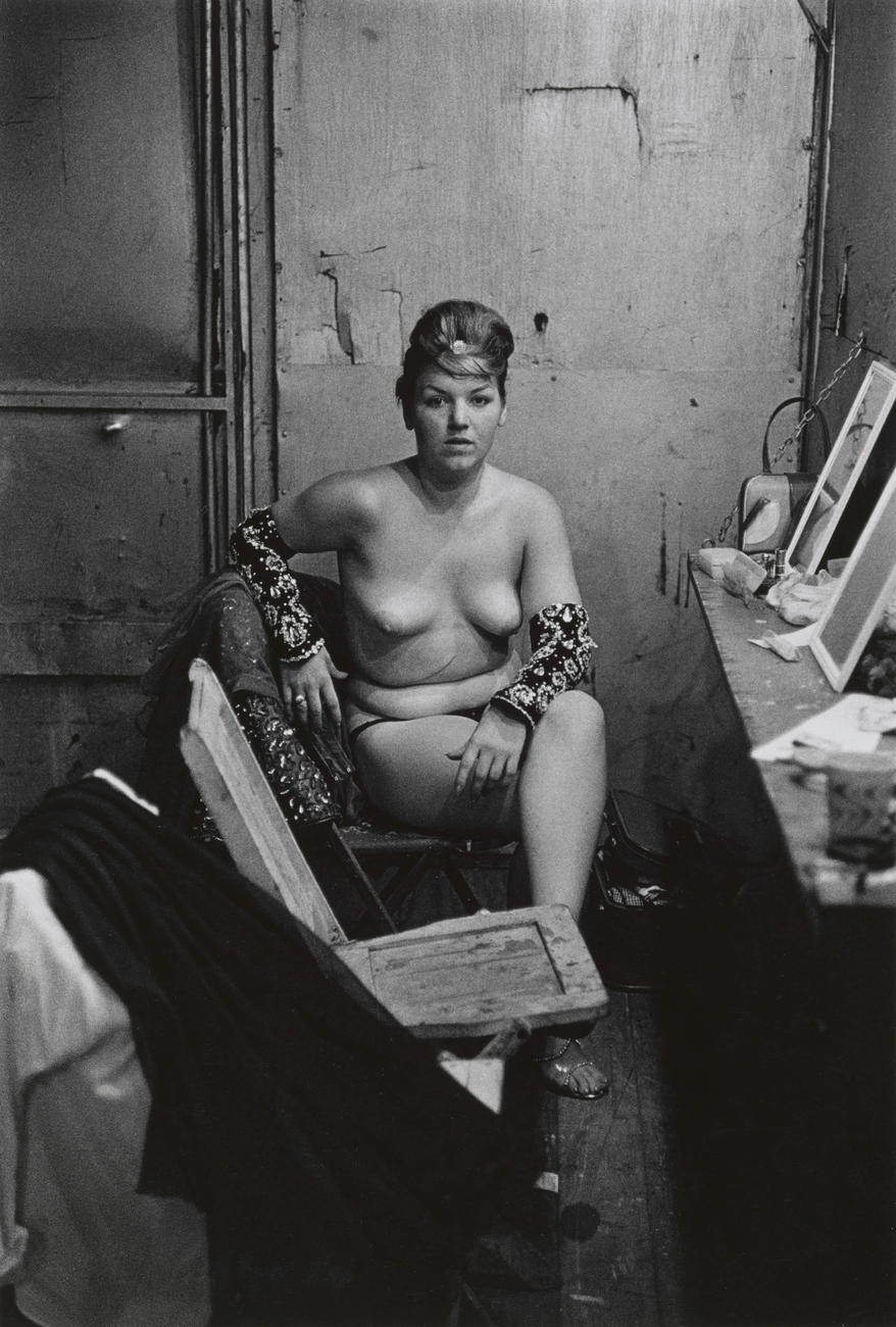 Artwork image, Diane Arbus, Stripper with bare breasts sitting in her dressing room