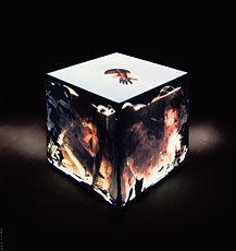 cube with abstract projected images with dark background