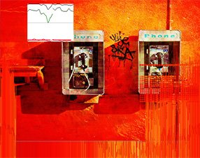 graffiti wall with two telephone booths