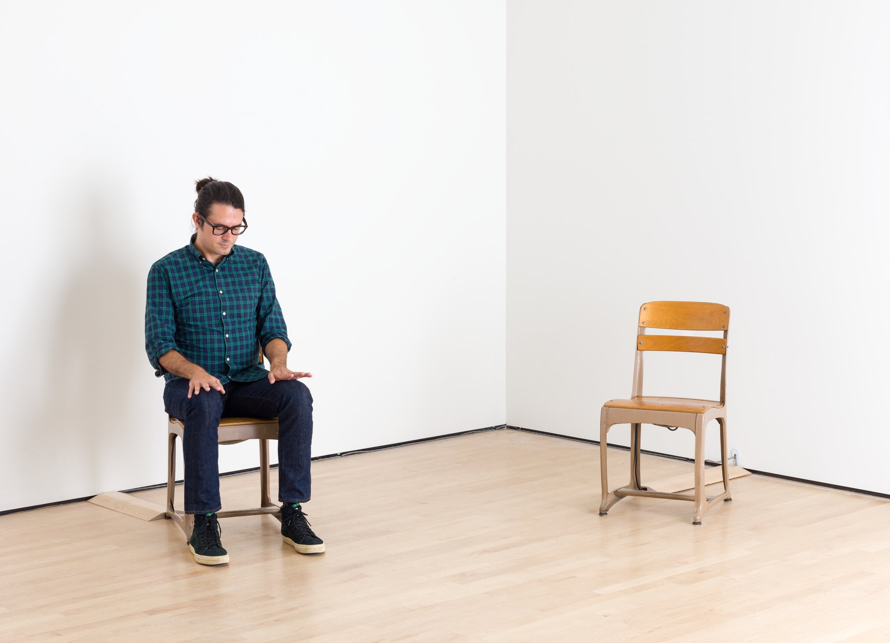 A Caucasian man with dark hair and glasses sits on one of two school chairs, Tcherepnin, Soundtracks