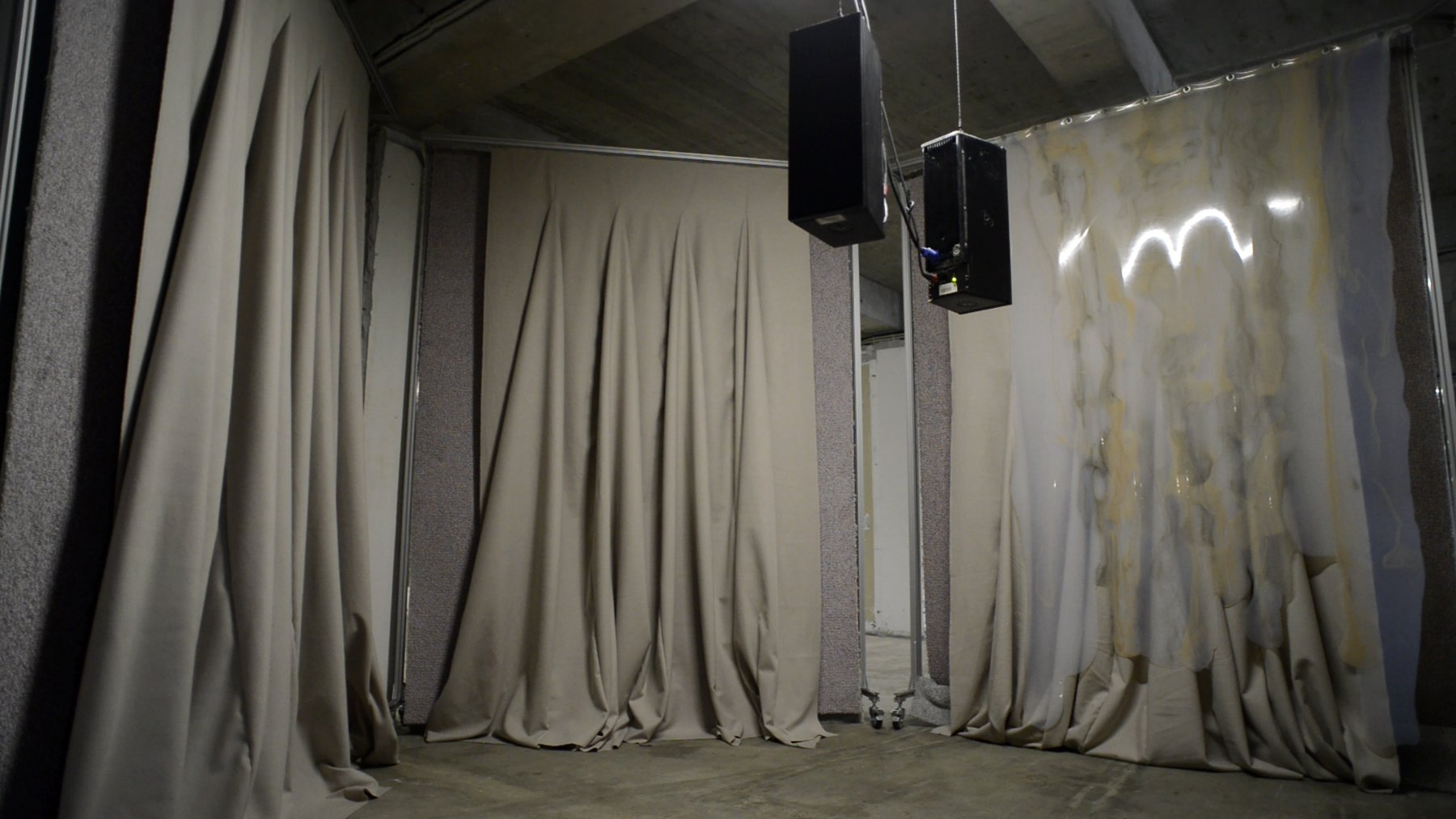 A curtained room with a speaker hanging down, Gordon Soundtracks