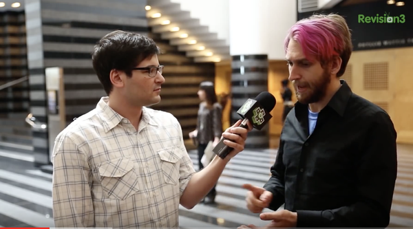 A man is interviewed in Botta atrium during Ahhhcade