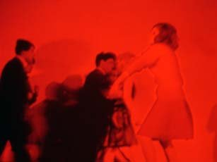 Anne Colvin, video still, red image of four people dancing