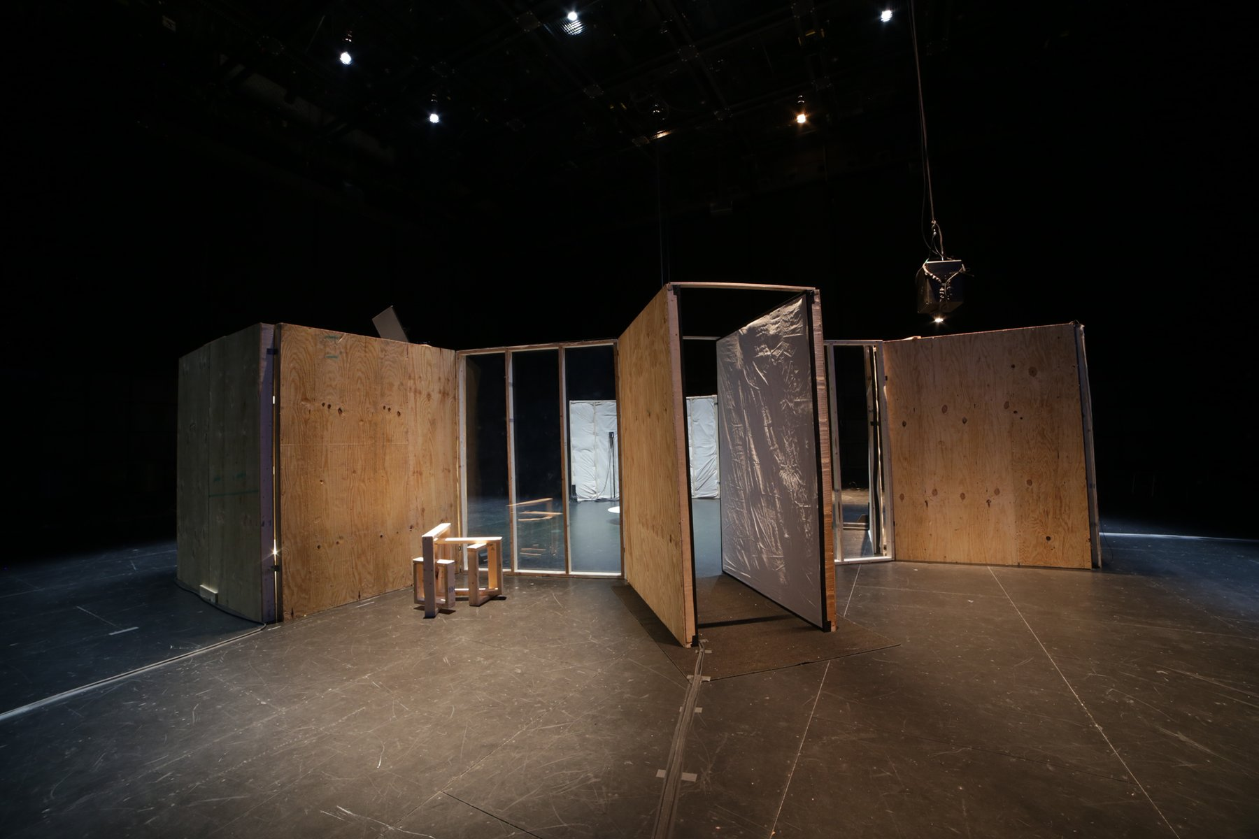 A dark room with rectangular wooden structures installed, Gordon Soundtracks