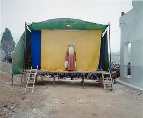 A color photograph of a makeshift stage, Luo Dan