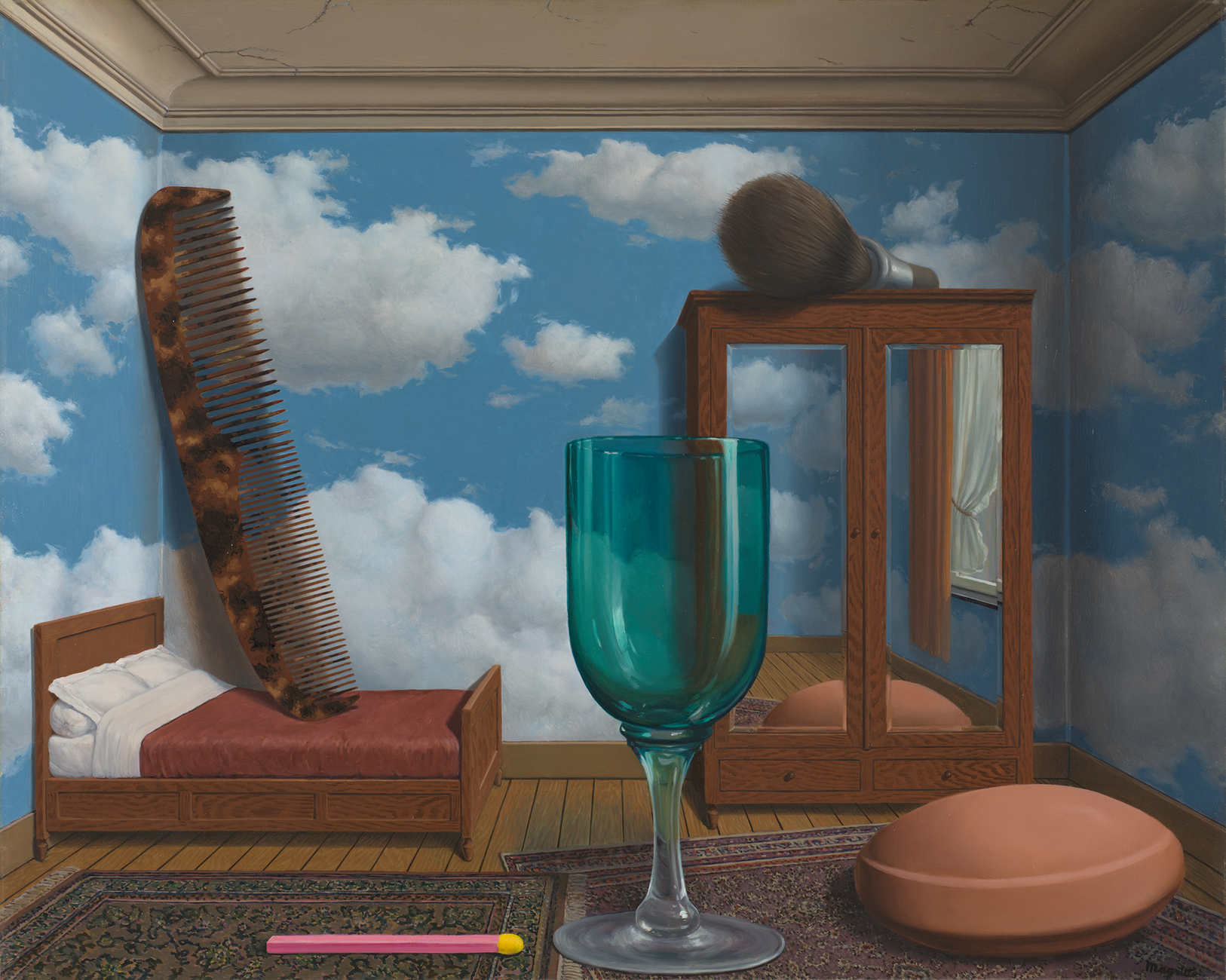 A large green glass wineglass, a match, and pill on two overlapping persian rugs in a room with walls painted like a cloudy sky and also containing a bed with a giant comb and a mirrored armoire with a large shaving brush on top
