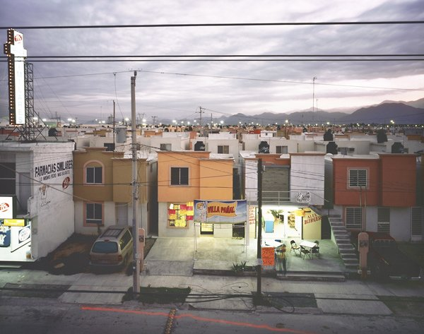 photo of store fronts and buildings in Mexican town