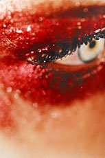 corner of eye covered in red makeup