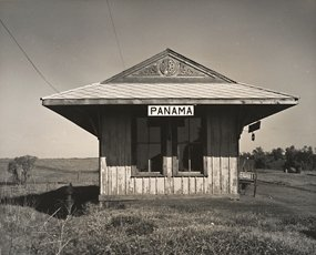 Wright Morris, photo of smalll hut in rural field with Panama sign