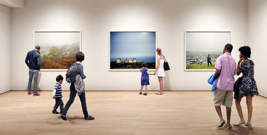 Visitors in a gallery look at large-format photography