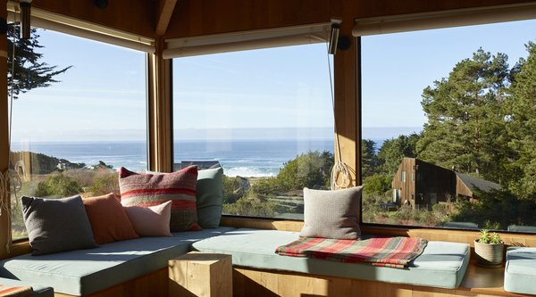 A color photograph of an interior with views of The Sea Ranch landscape