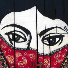 An illustration of a woman's eyes with a bandana over her mouth