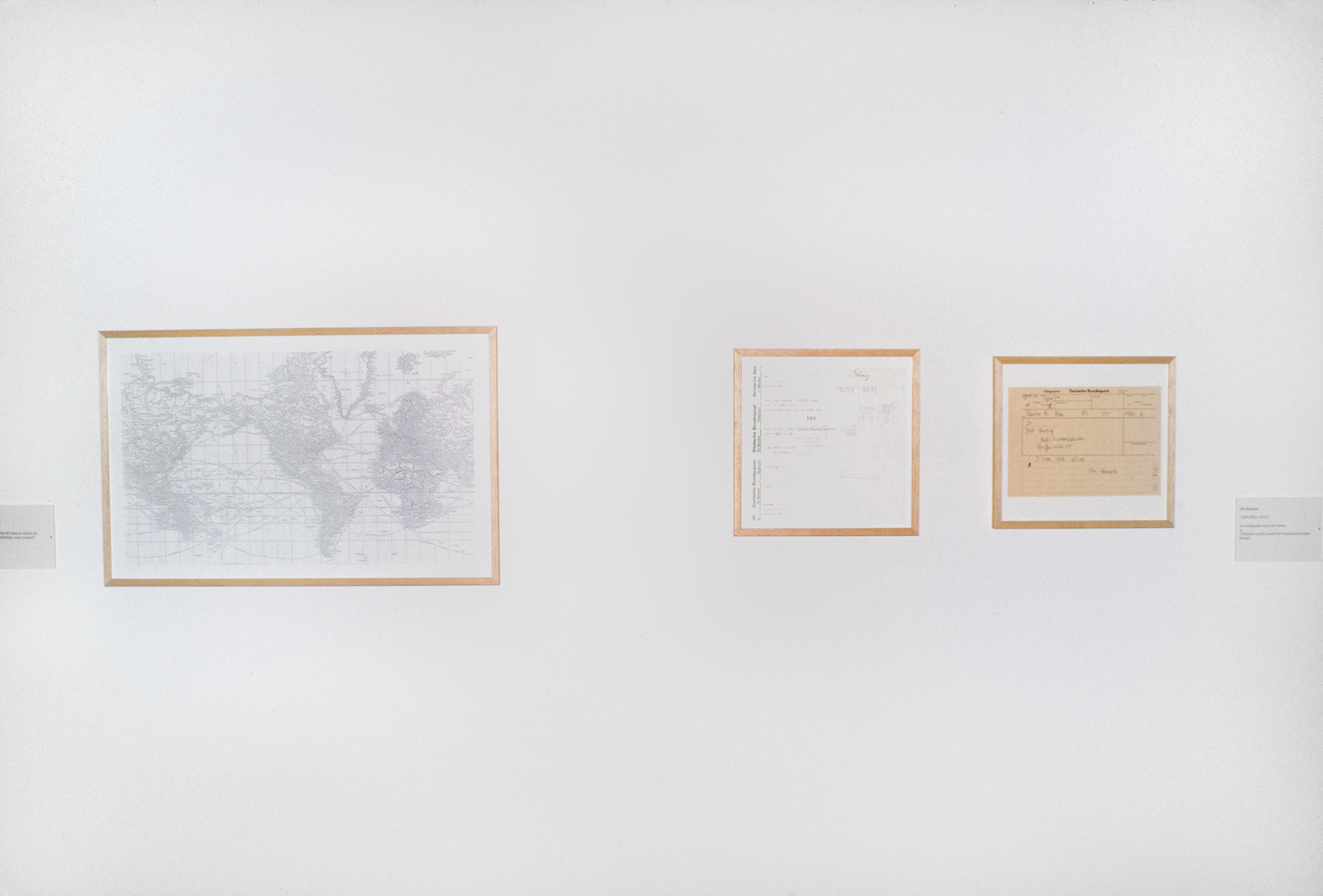 A map and other documents framed and hung on a wall
