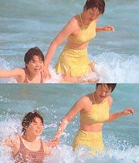Streuli, woman and daughter swimming in ocean