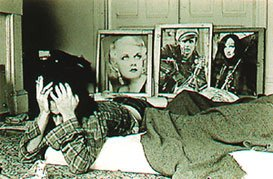 William Gedney, man on bed with three framed photos in back