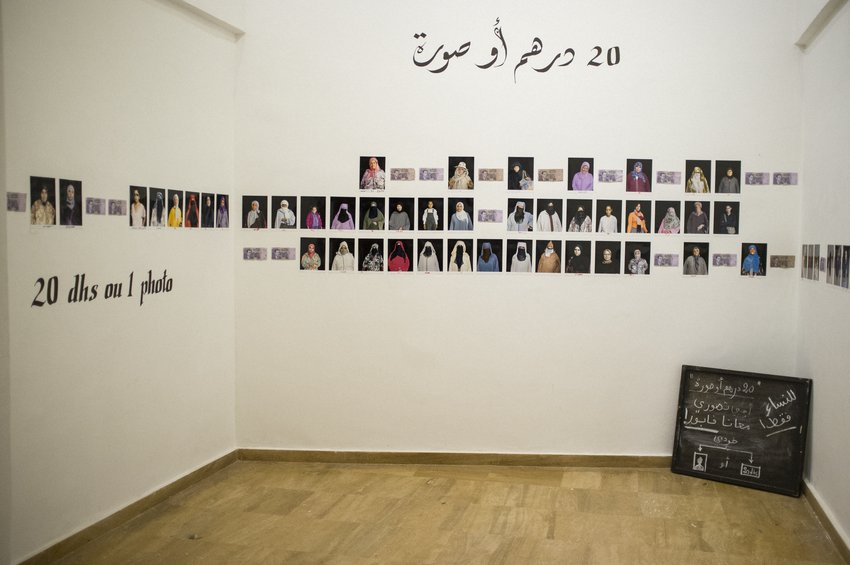 Installation image of Susan Meiselas' 20 dirhams or 1 photo