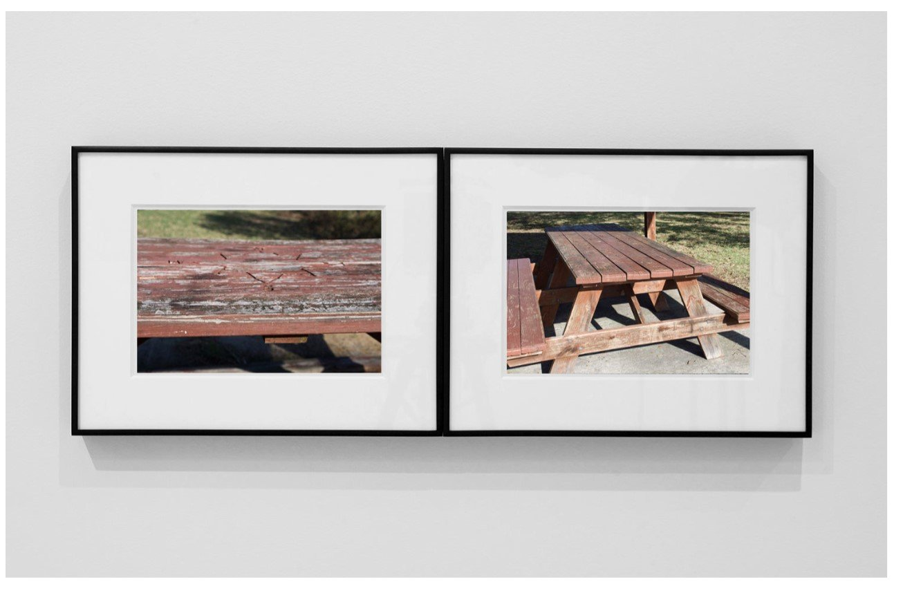 Two framed photographs of picnic benches