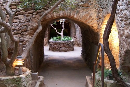 stone archway and trees in Underground Gardens