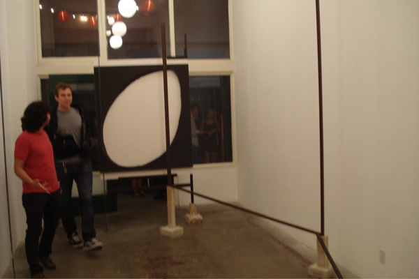 At the Muchael Rashkow opening. Those two guys will give you a sense of the work's scale.