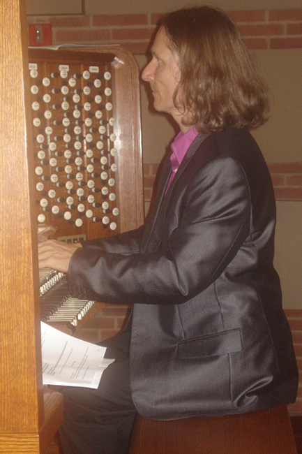 Christophe Bull, official organist at Royce Hall at UCLA, playing the Jupiter Symphony as the crowd keft the auditorium