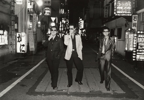 Katsumi Watanabe, Untitled [Three men with cigarettes, posing in the street], ca. 1970, printed 1985; Promised gift of Paul Sack to the Sack Photographic Trust © Estate of Katsumi Watanabe