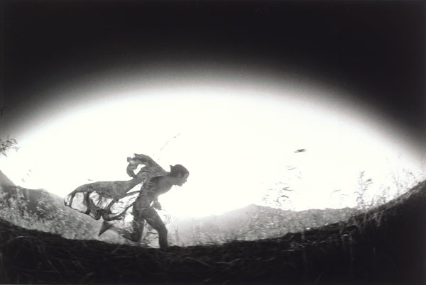 Eikoh Hosoe, Kamaitachi #31 [Caped Kamaitachi running through field], 1968, printed 1971; Promised gift of Paul Sack to the Sack Photographic Trust