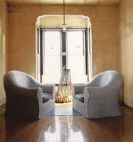 David Ireland, Installation view of 500 capp street, 1985 South China Chairs, 1979 Broom Collection with Boom 1978-1988