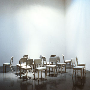 David Ireland: School of Chairs, 1988; ca. 16 chairs made of metal, fabric, and wood; overall ca. 32 x 96 x 96 in.; installation view of David Ireland's 1988 MATRIX exhibition, courtesy of the University of California, Berkeley Art Museum and Pacific Film Archive. Photo: Ben Blackwell.