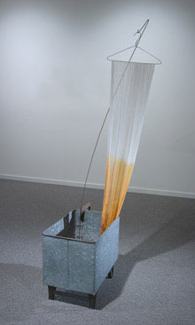 David Ireland, Untitled (Capillary Action), 1995; galvanized steel, cheesecloth, salt, dye, and wire. 78x24x14; Berkeley Museum of Art collection